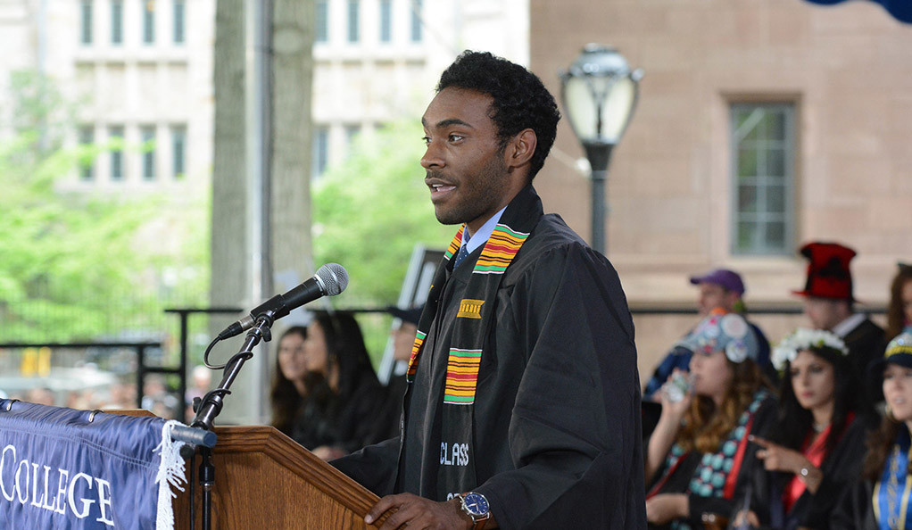 Larry Fulton '19 speaks at the pdium on Class Day