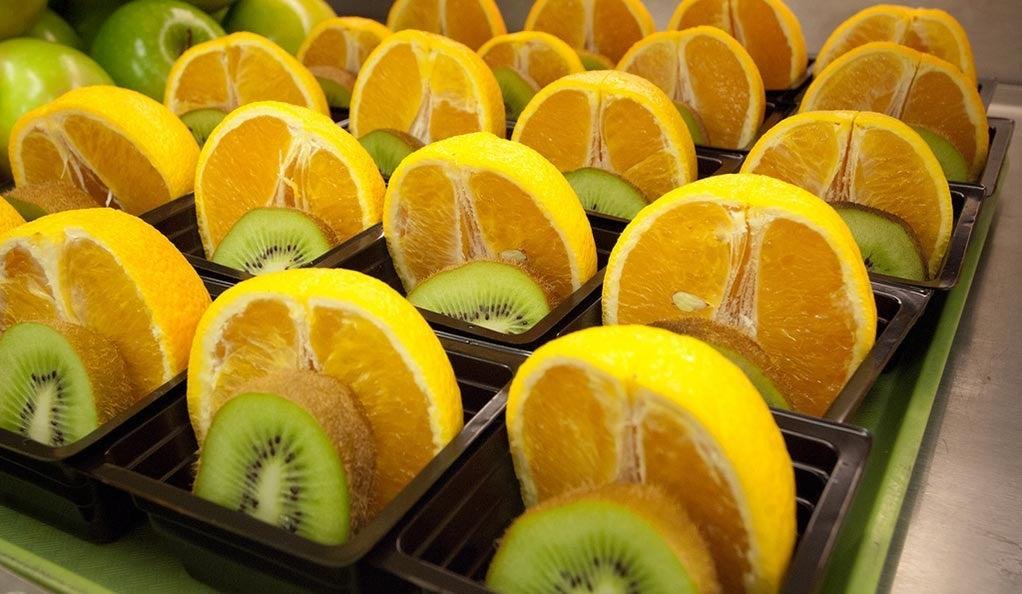 Fresh orange and kiwi fruit cups for the National School Breakfast Program