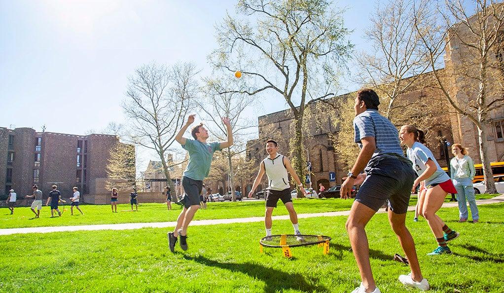 A coed game of spikeball near Ezra Stiles College.