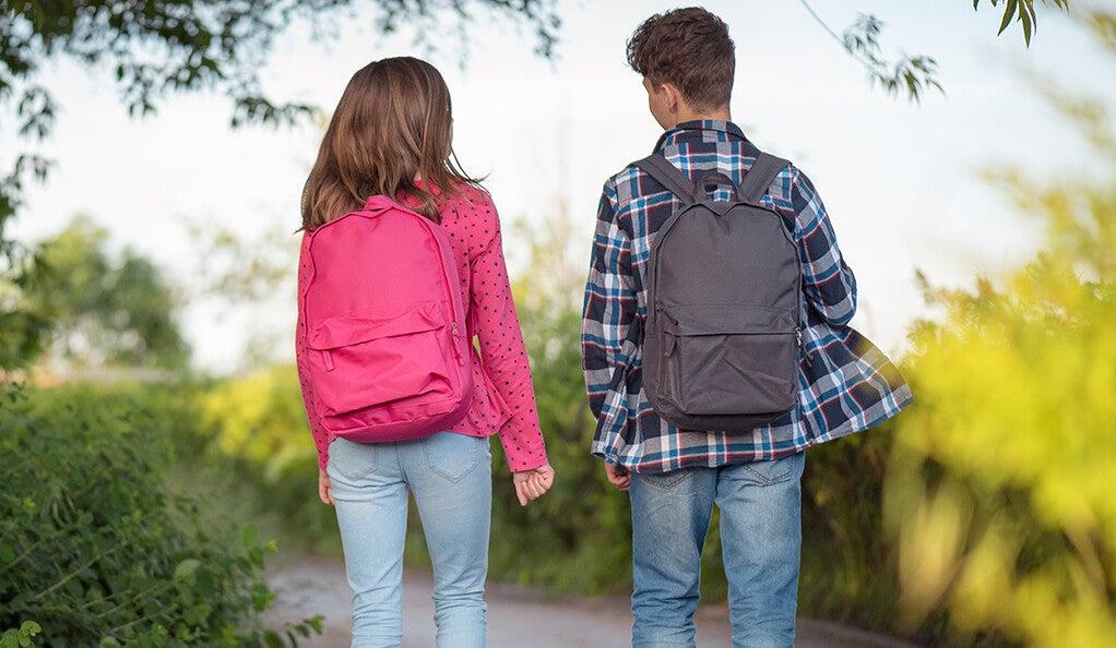 Girl and boy walking to school.