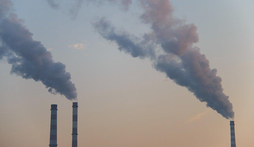 A trio of smokestacks emitting air pollution.