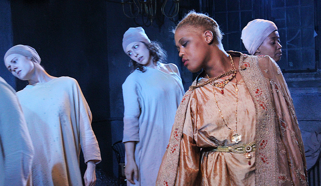 "A scene with four actors is depicted from the Yale Summer Cabaret's production of ""The Trojan Women."""