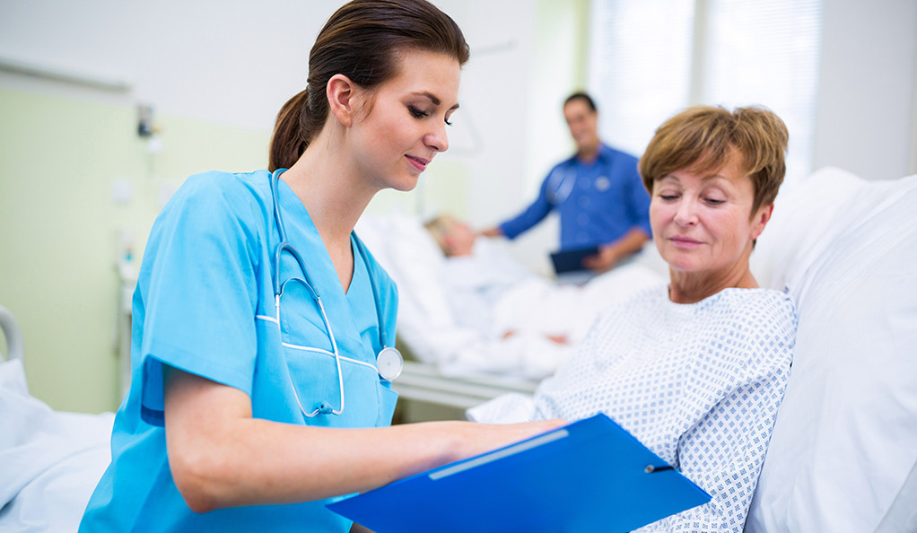 Stock image of nurse and patient in hospital.