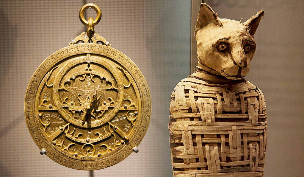 A photo of an astrolabe and an Egypt mummified animal.