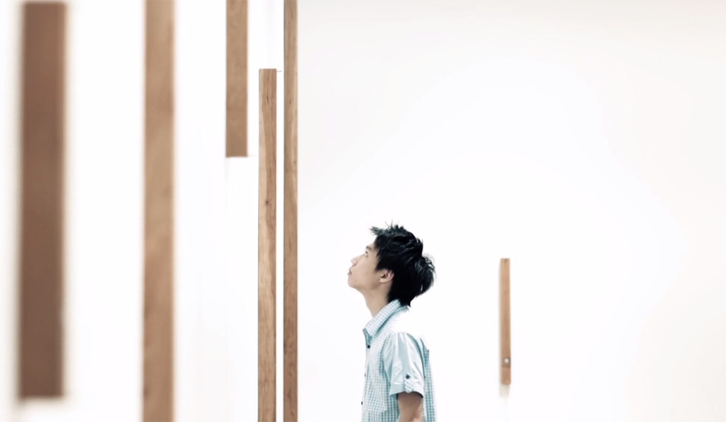 A young man looking at an art installation.