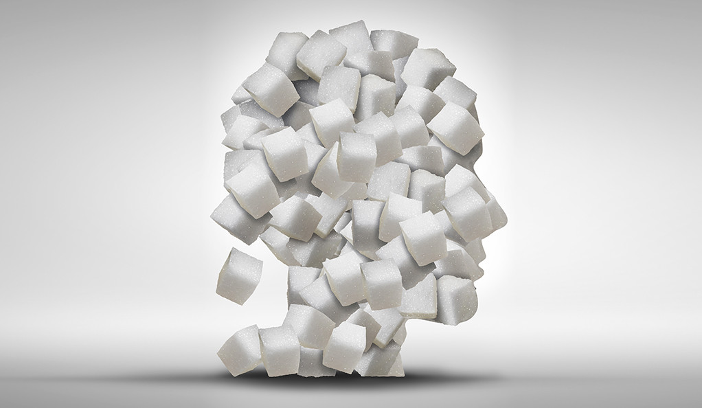 A grapic representation of sugar cubes in the shape of a human head.