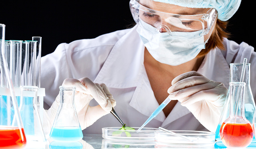 A scientist working in the lab.