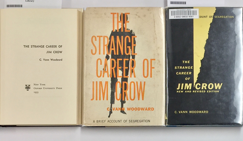 "Different editions of C. Vann Woodward's book ""The Strange Career of Jim Crow"" on display."