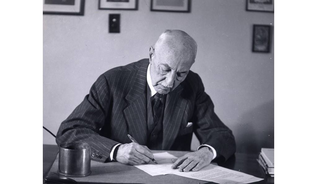 C-E.A. Winslow working at his desk.