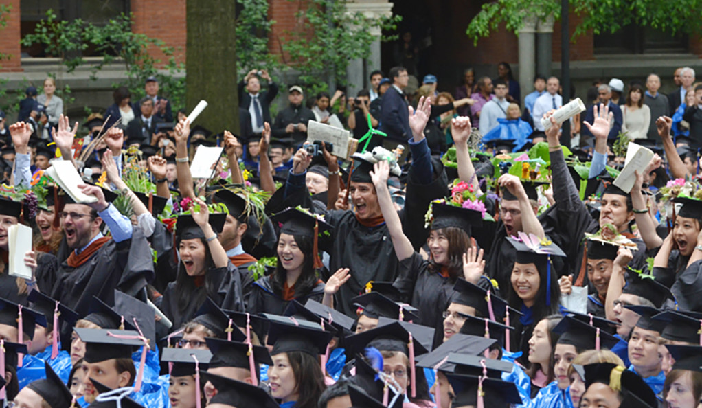 Graduates cheering at Yale Commencement 2012.