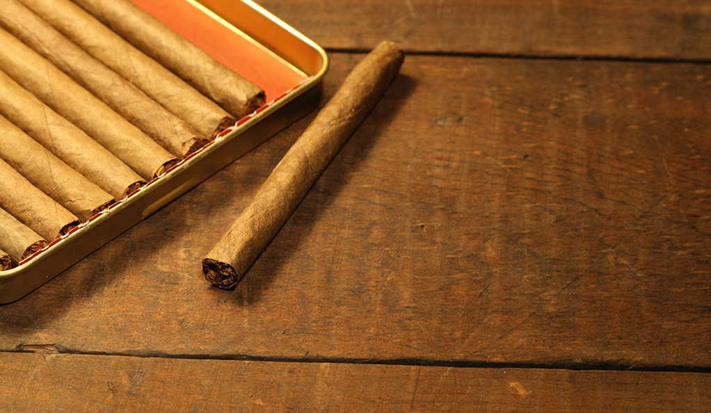 Cigarillos on a wooden table.