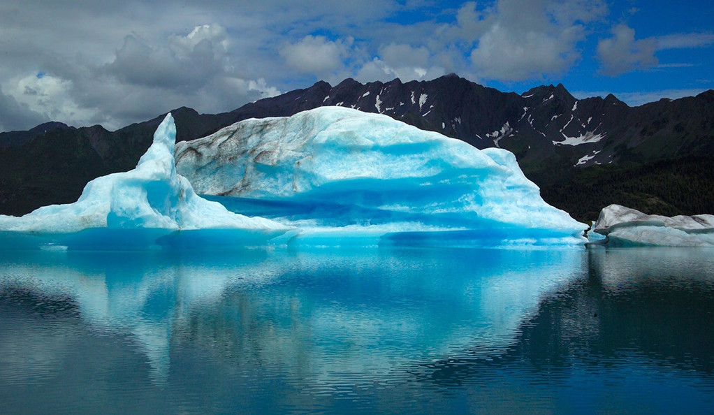 A glacier with water in the foreground.