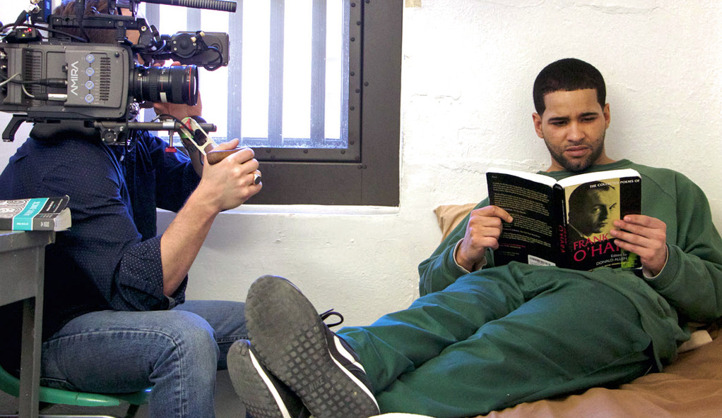 """An incarcerated student is filmed reading poems by Frank O'Hara for the documentary """"College Behind Bars."""""""