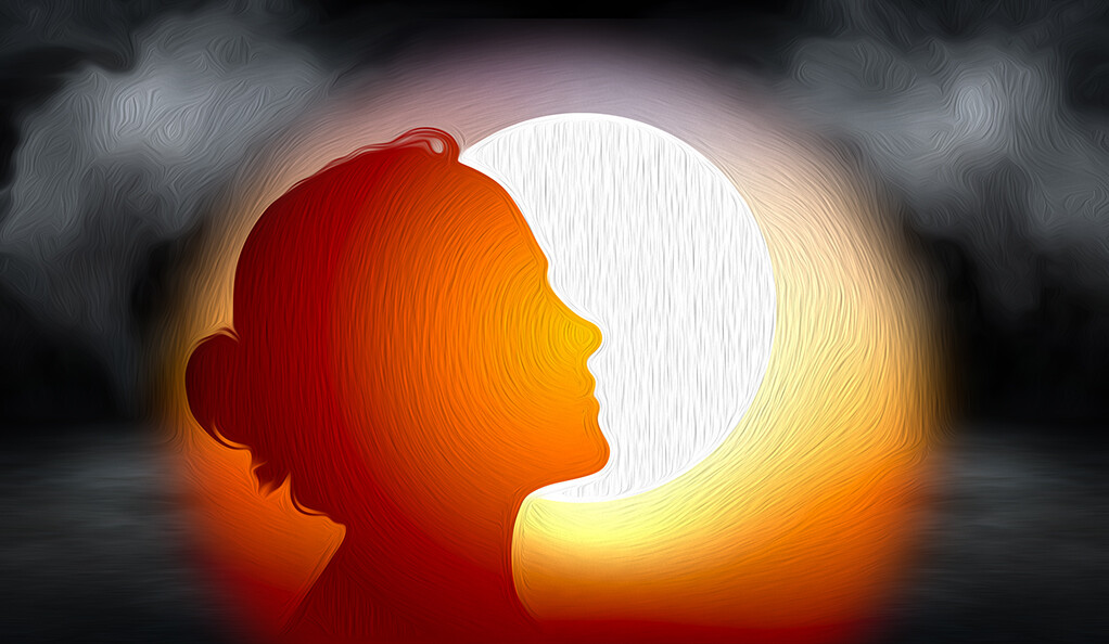 Woman with sun behind her and dark clouds in the distance.