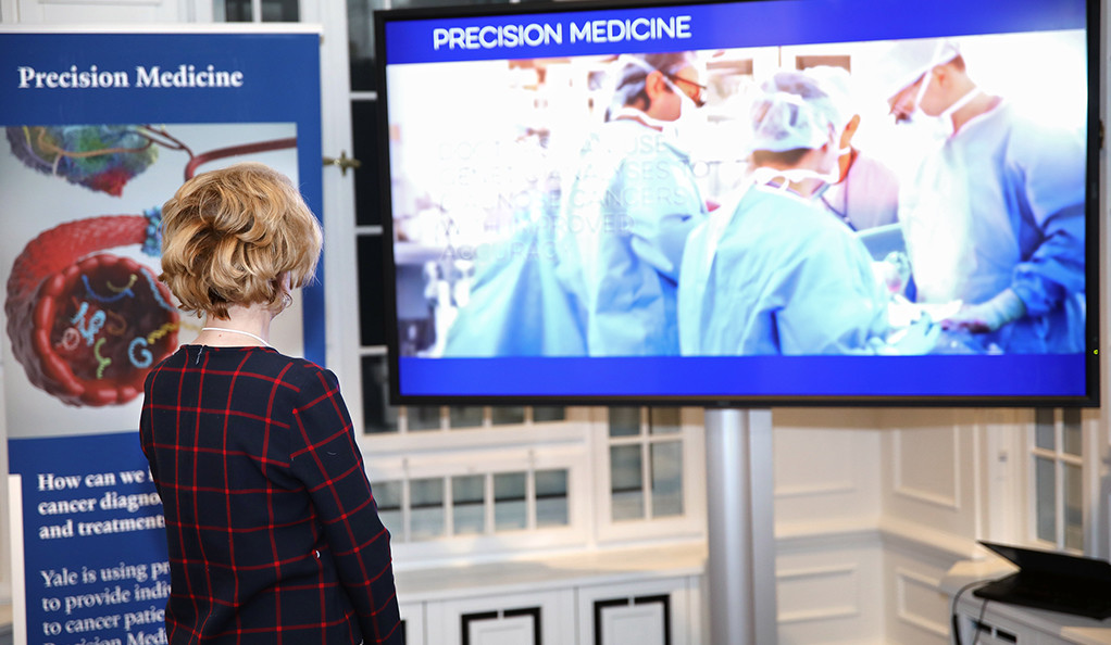 A woman watches a video about precision medical tech at the World Economic Forum in Davos, Switzerland