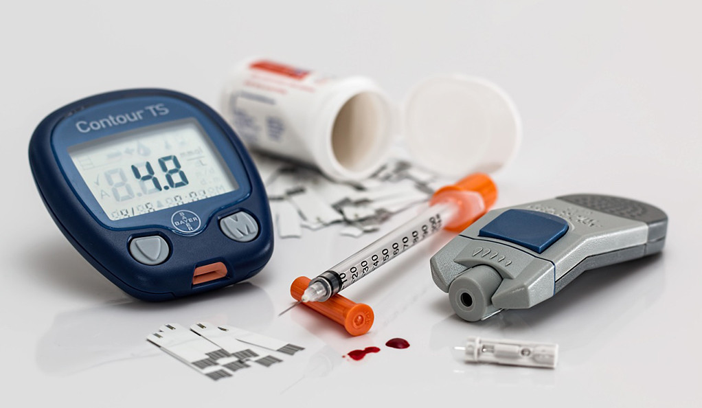 Diabetes testing equipment on display on a white table.