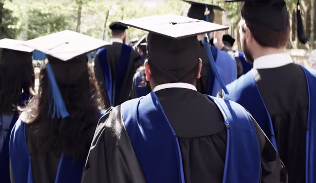 Yale graduates in gowns and mortarboards.