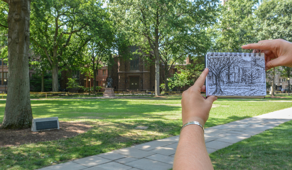 A black-and-white pen sketch of Dwight Hall in front of the building on Old Campus on a sunny day.