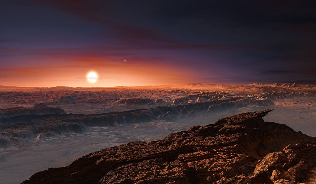 This artist's impression shows a view of the surface of the planet Proxima b orbiting the red dwarf star Proxima Centauri