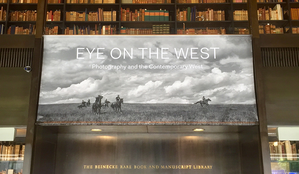 A banner for the Eye on the West exhibit on display at the Beinecke library at Yale.