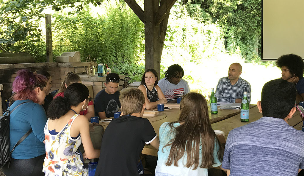 Yale professor Ziad Ganim with students from the  Pathways to Science Summer Scholars program at Yale Farm.