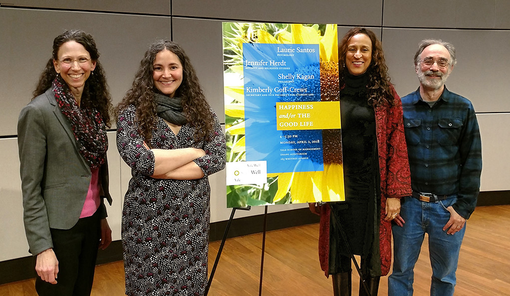 Jennifer A. Herdt, Laurie Santos, Kimberly Goff-Crews, Shelly Kagan posing with 'Happiness and the Good Life' poster
