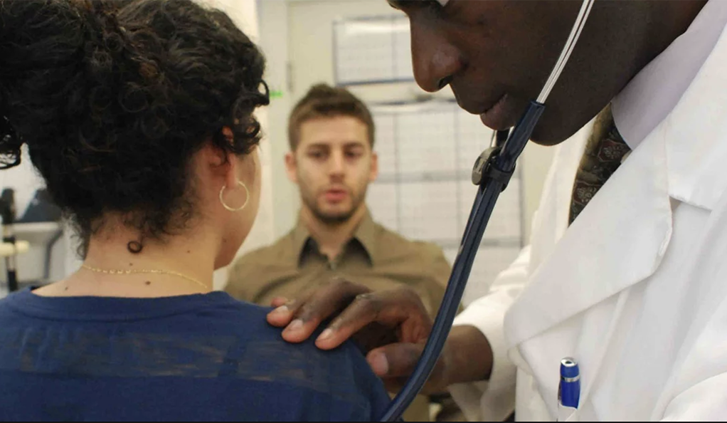 A doctor examining a patient at HAVEN Free Clinic in New Haven.
