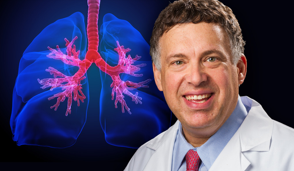 Dr. Roy Herbst alongside an illustration of human lungs.