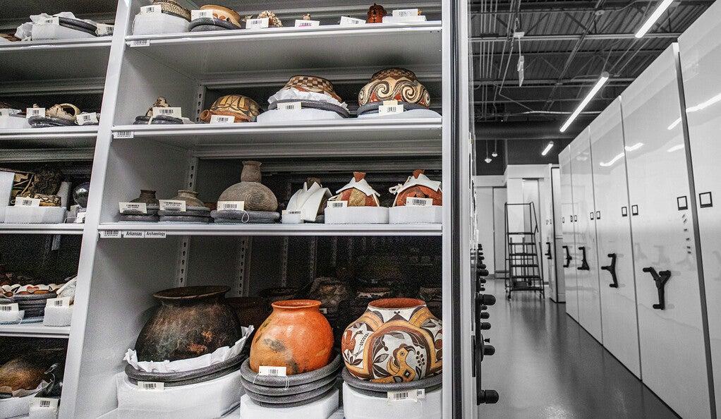 Several ceramic pots on shelves.