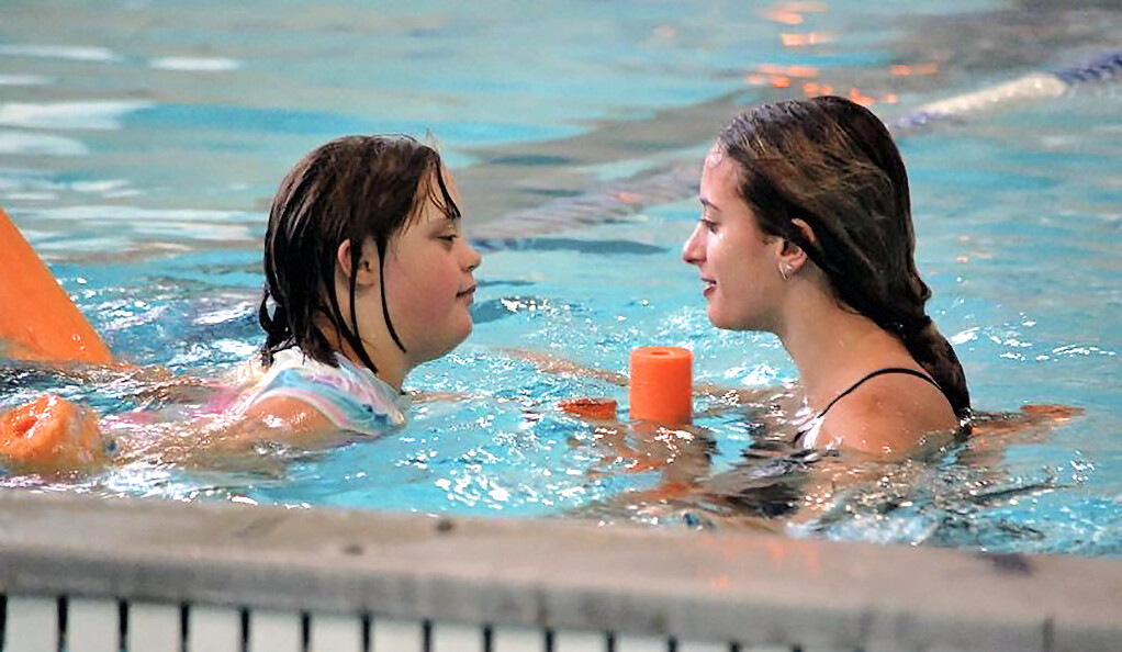 Two people in a swimming pool.