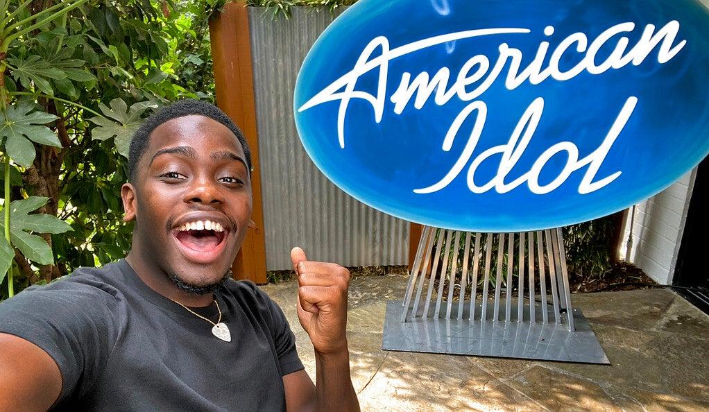 Xavier Washington with an American Idol sign behind him.
