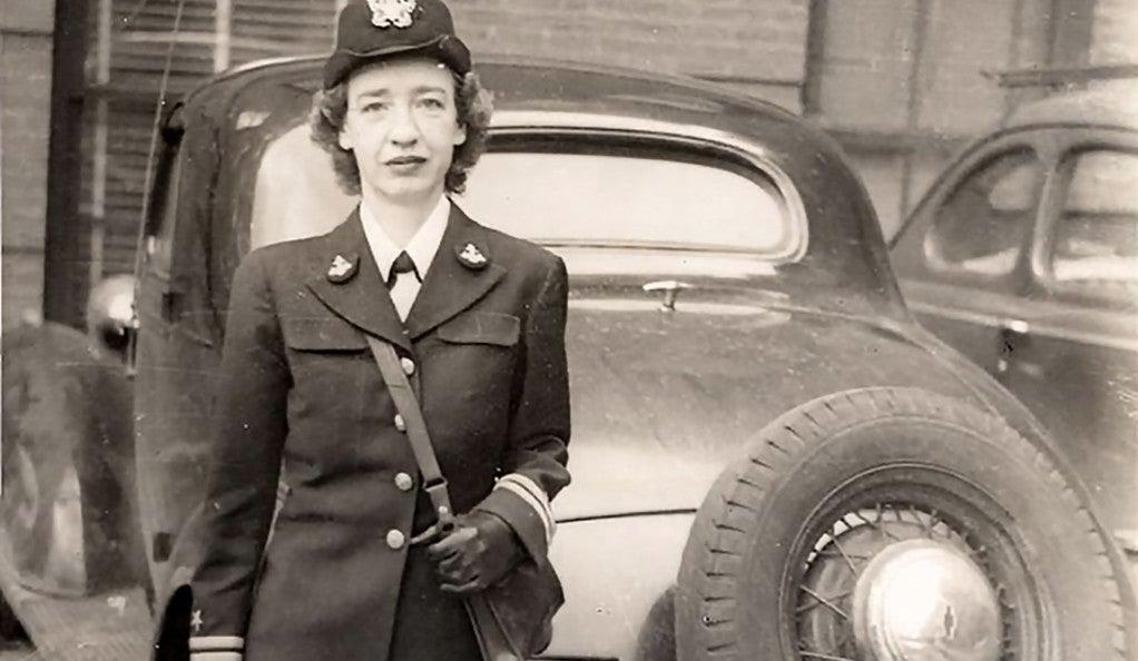Hopper standing behind a car parked near Cruft Lab, Harvard University, ca. 1945–1947
