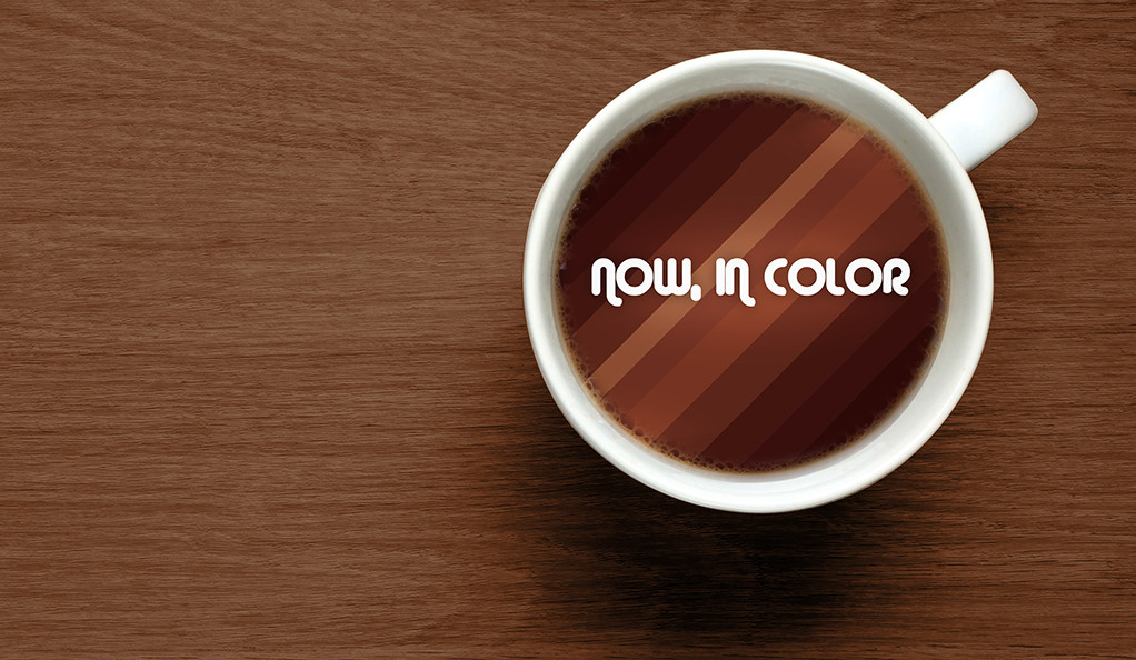 Now, In Color promotional image, with the documentary title in a cup of hot chocolate
