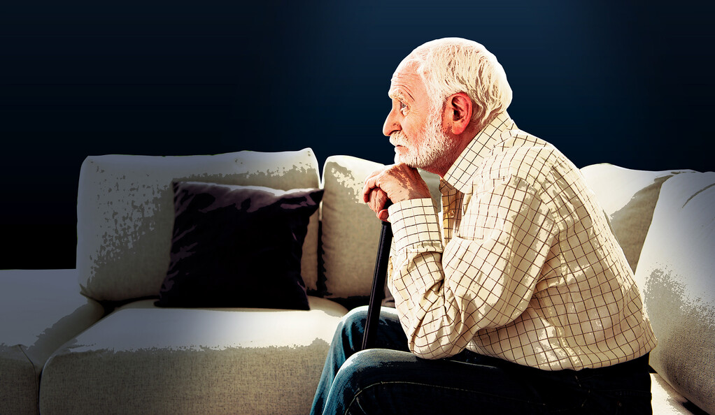 Older man sitting alone.