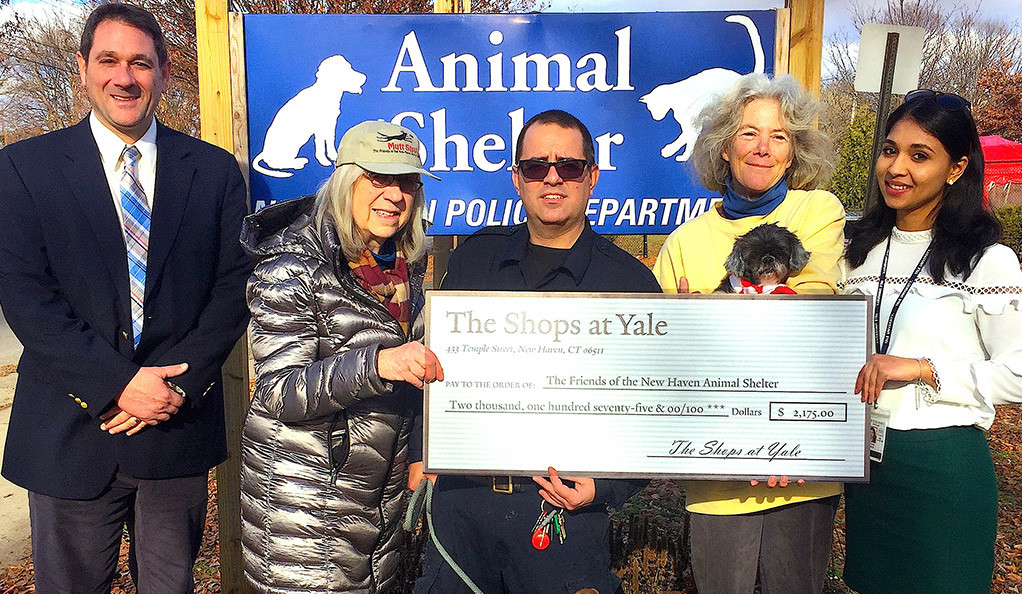 Photo of individuals from an animal shelter receiving a check.