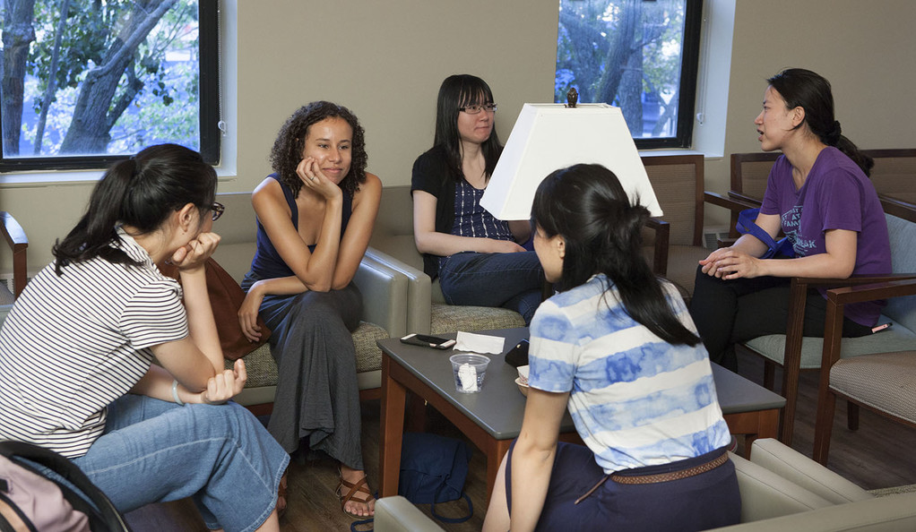 Students socialize in the common room of the McDougal Center.