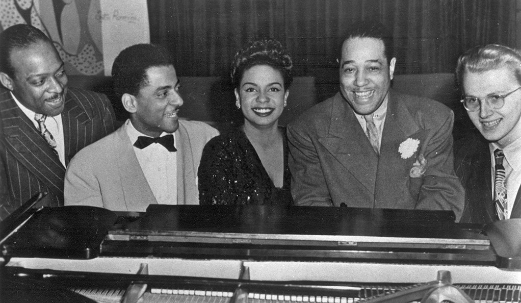 From the Gilmore Music Library at Yale: A photo of Count Basie, Teddy Wilson, Hazel Scott, Duke Ellington, and Mel Powell.