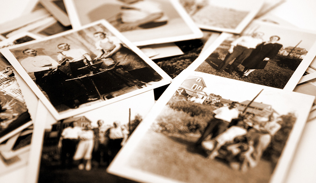 A pile of old black and white snapshots.