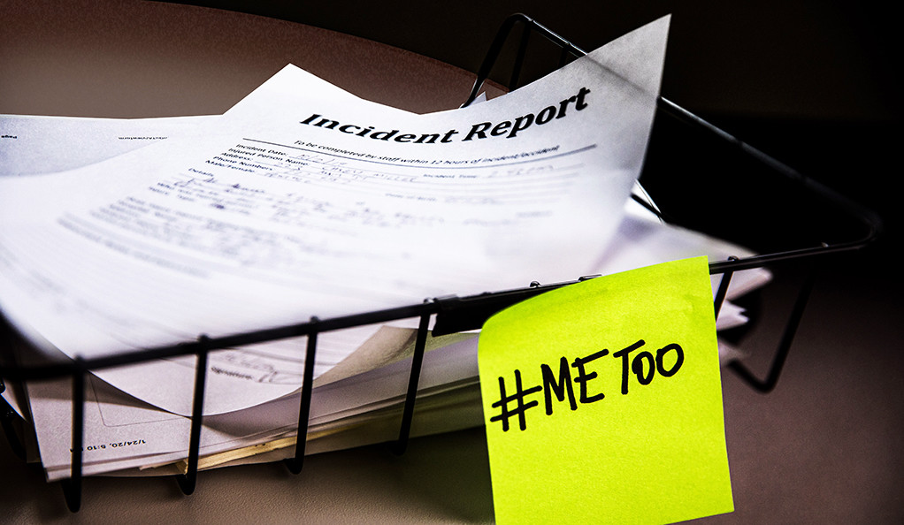 A police incident report with a #MeToo post it note