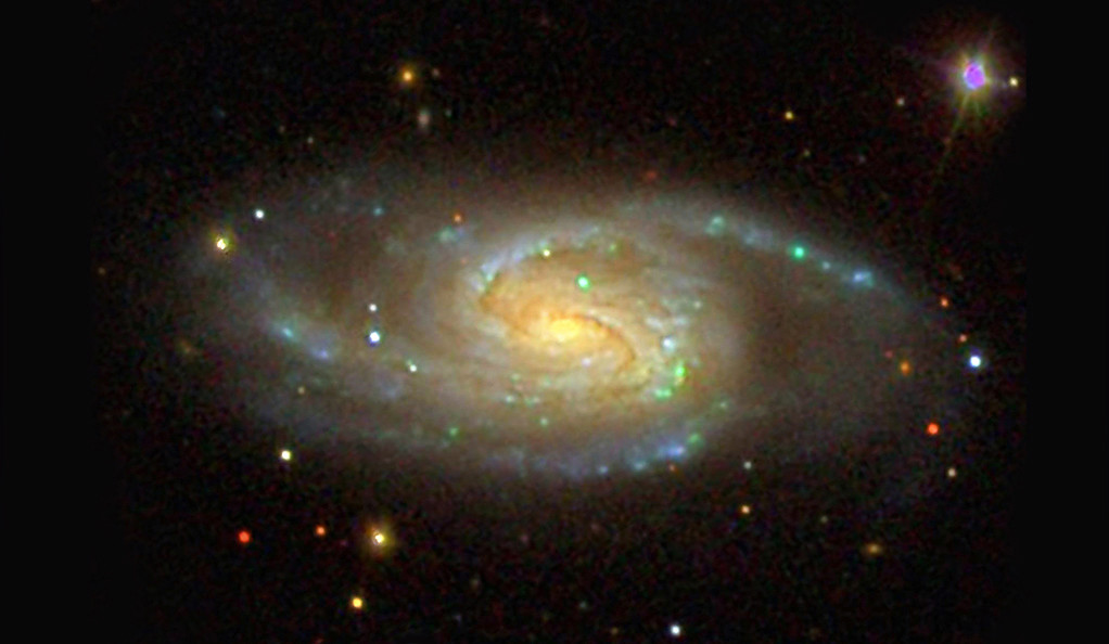 A three-color optical image of a Milky Way galaxy.