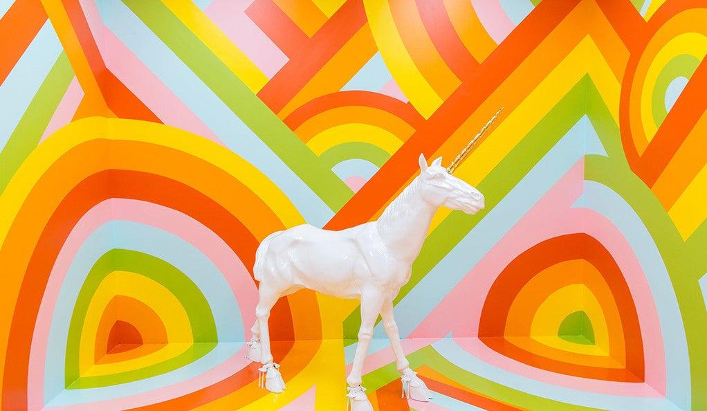 "The rainbow-walled ""unicorn room"" in the Museum of Ice Cream."