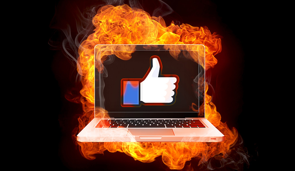A graphic image of a raised thumb in front of a burning computer monitor.