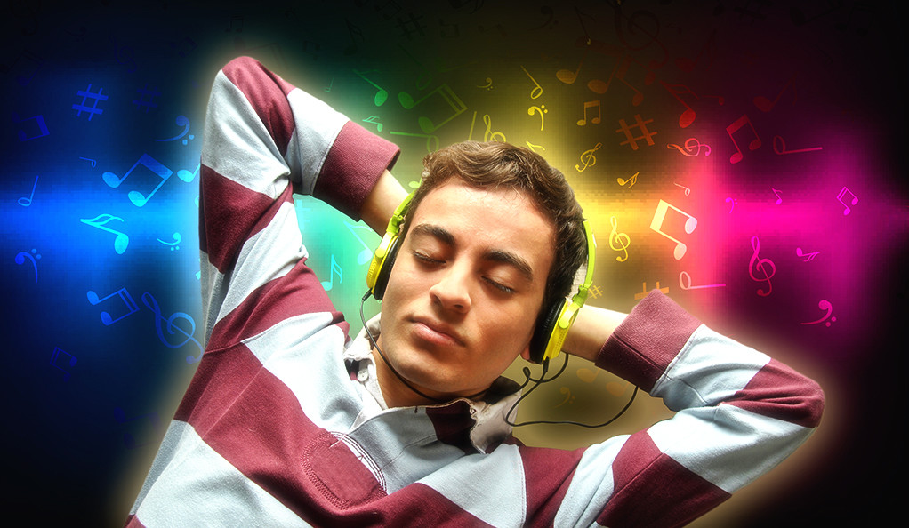 A man listening to music with his hands behind his head, and an illustrated notation collage the background.