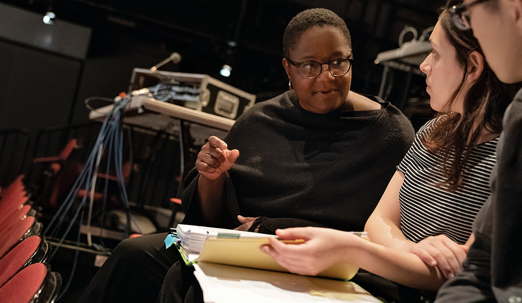 Narda E. Alcorn, chair of stage management, with students