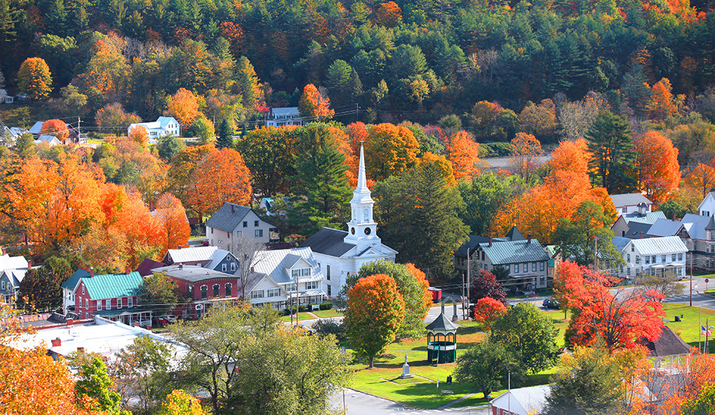 An aerial view of a small New England town in autumn.