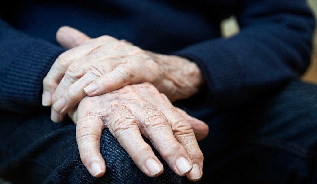 An elderly person's hands.