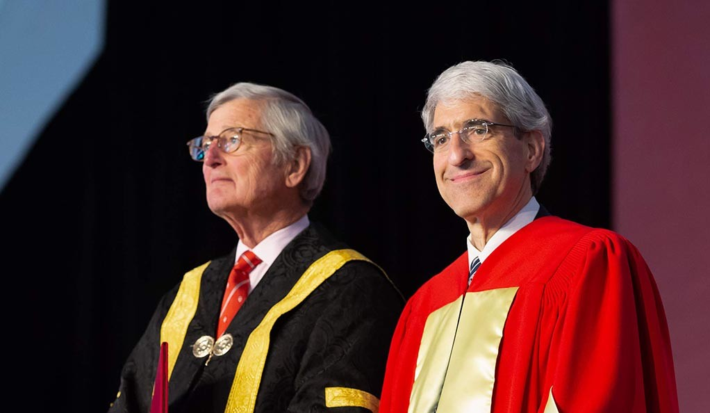 Yale President Peter Salovey with McGill University Chancellor Michael Meighen on stage at McGill's June 5 convocation ceremony.