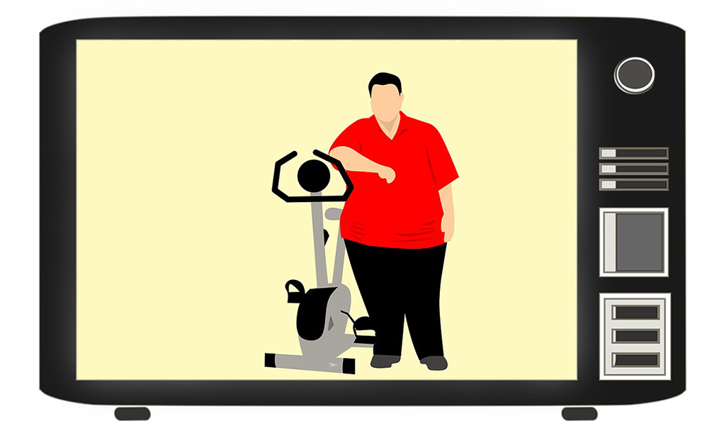 An illustration of an obese man standing next to an exercise bike on television.