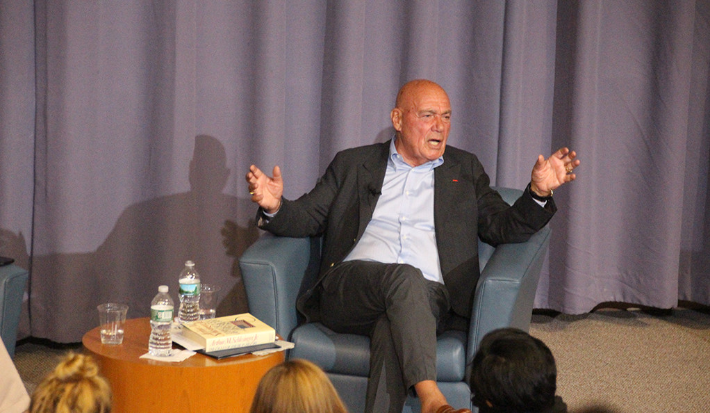 Vladimir Pozner sitting on stage during a question-and-answer session at Luce Hall at Yale.