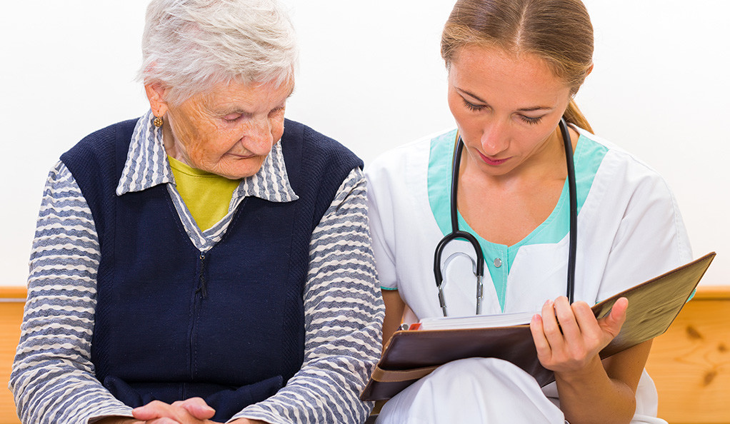 An elderly woman consulting with her doctor.